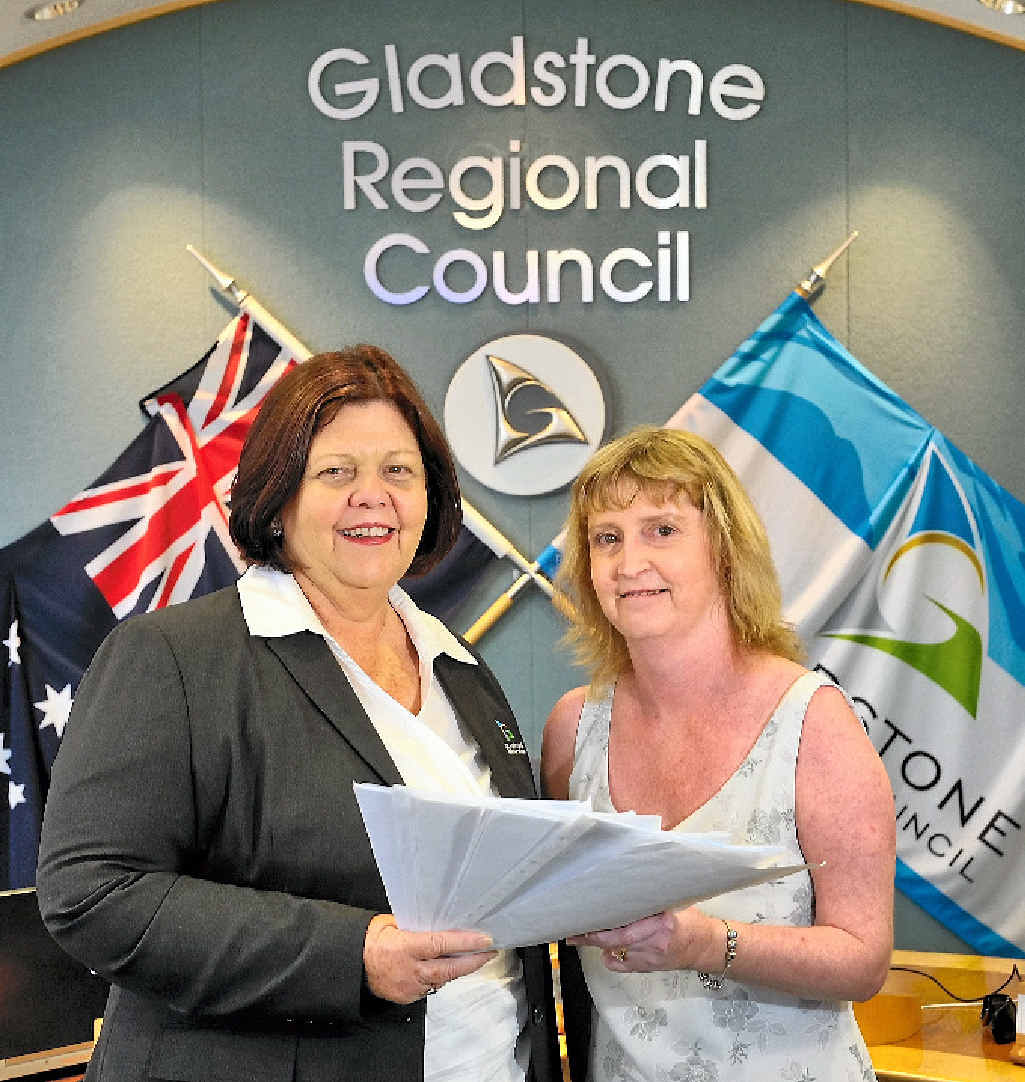 PUBLIC POOL PUSH: Justine Hartley presenting her petition calling for a public swimming pool in BITS to Mayor Gail Sellers.