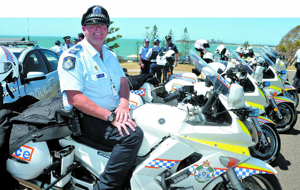 OUT IN FORCE: Sergeant Brad Britton and a host of other police make their presence felt at Alexandra Headland.