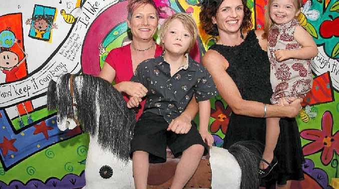 LIVES TURNED AROUND: Sam Cloy and her son Max Hefferan, left, and Simone Essex and her daughter Leuca at Sunshine Coast Children's Therapy Centre in Nambour.