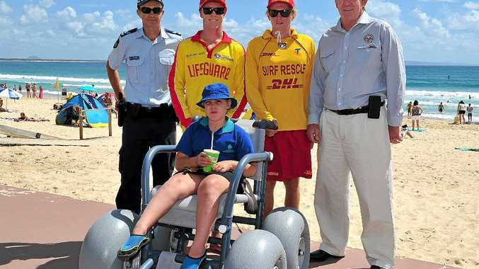 ACCESS EASY: Nambour Special School student Lily Westcott heads to the beach.