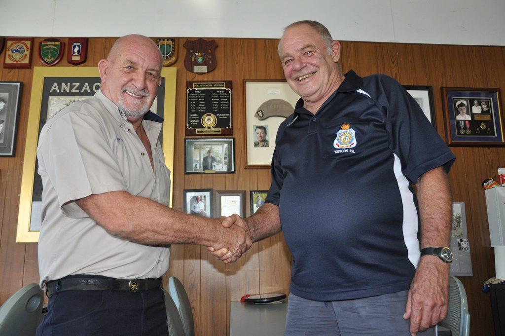 New Yeppoon RSL Sub-branch President Chris Penglase was congratulated by retiring President Wayne Carter last week. Photo Trish Bowman / Capricorn Coast Mirror