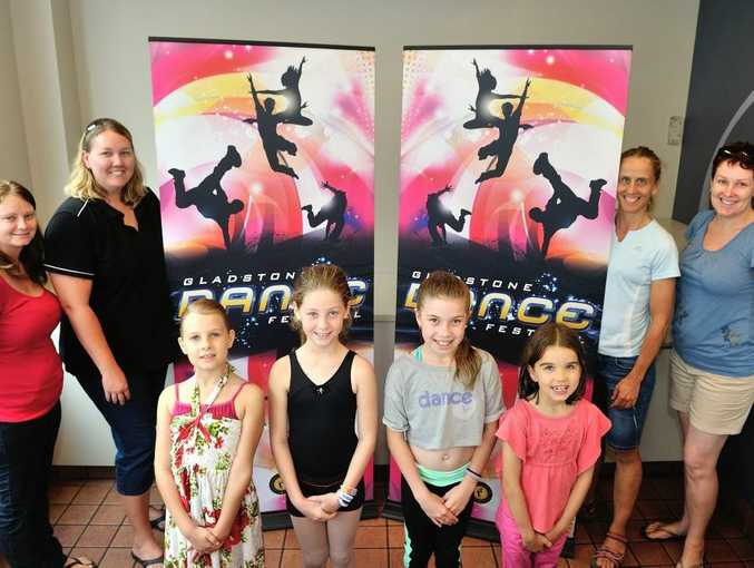 Organisers and participants are excited for the upcoming 2014 Gladstone Dance Festival. Front row (L-R): Charlotte Leu, 8, Sarah Kadel, 10, Ellah-Josie Ching, 10, and Sasha Carter, 8. Back row (L-R): Volunteer Kim Kadel, Gladstone Dance Festival Association secretary Christine Leu, Gladstone Dance Festival treasurer Kate Maslen and Gladstone Dance Festival trophy clerk Lynda Ninness.