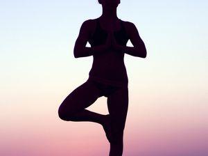 Man climbs Glasshouse Mountain naked to strike yoga poses