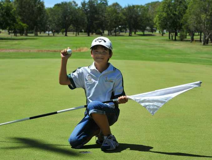 Michael Baker chips one in from 100m away when competing in the Bundaberg Junior Classic.