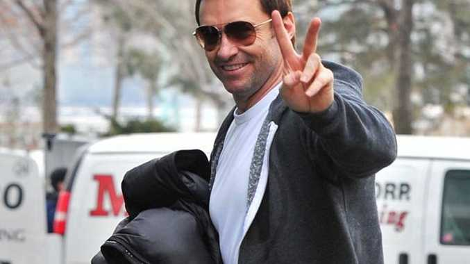 Hugh Jackman flashes a smile and a peace sign and he completes a workout in New York City.  Pictured: Hugh Jackman Ref: SPL688641 270114  Picture by: Asadorian-Mejia/Splash  Splash News and Pictures Los Angeles: 310-821-2666 New York: 212-619-2666 London: 870-934-2666 photodesk@splashnews.com