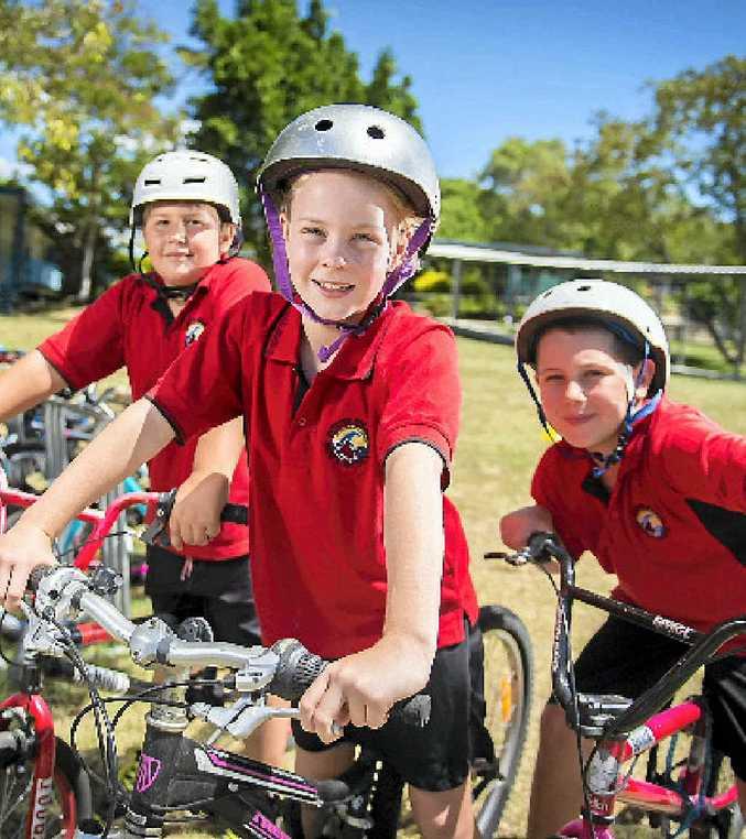 Boyne Island State School Year 3 students Jack Holt, 8, Sally Vagg, 7, and Luke Pfeiffer, 8, enjoy bike riding.