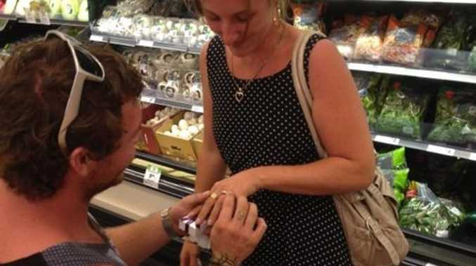 Warana's Clayton Byrne got down on one knee and proposed to his girlfriend Amy Gotz in the fruit and vegetable section of Woolworths.