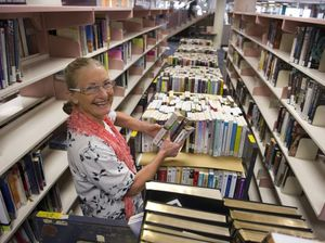 Librarian booked out with 100,000 titles to move to new home