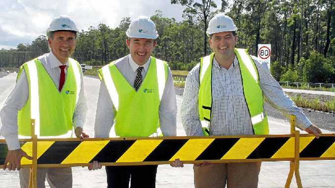 OPEN FOR BUSINESS: Clarence MP Chris Gulaptis, Page MP Kevin Hogan and Mayor of Clarence Valley Council/chair of the Pacific Highway Taskforce, Cr Richie Williamson, removing the barrier at the official opening of the Devil's Pulpit Pacific Hwy upgrade yesterday.