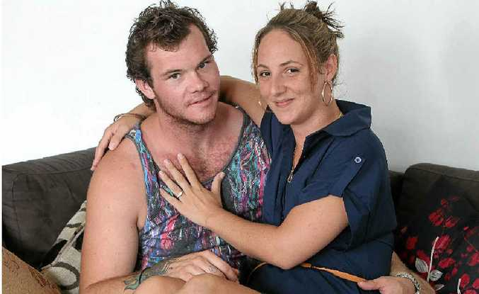 Clayton Byrne got down on one knee and proposed to his girlfriend Amy Gotz in the fruit and vegetable section of Woolworths.