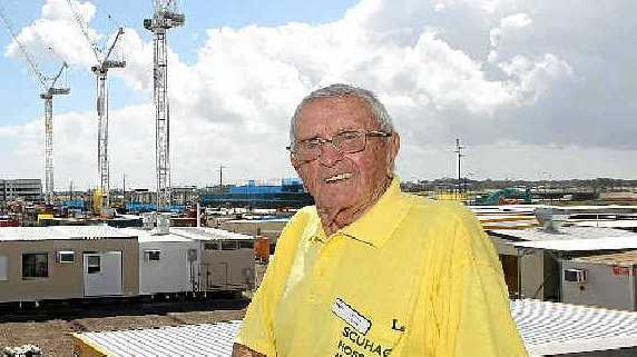 PLEASING INSPECTION: Avid campaigner for the new public hospital, Brian Ginn, visits the Kawana building site.