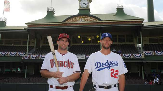 Major League Baseball players Los Angeles Dodgers star pitcher Clayton Kershaw (ight) and Arizona Diamondbacks first baseman Paul Goldschmidt (left) pose for photographs on the MLB pitch in front of the members stand at the Sydney Cricket Ground, Sydney, Wednesday, March 19, 2014.