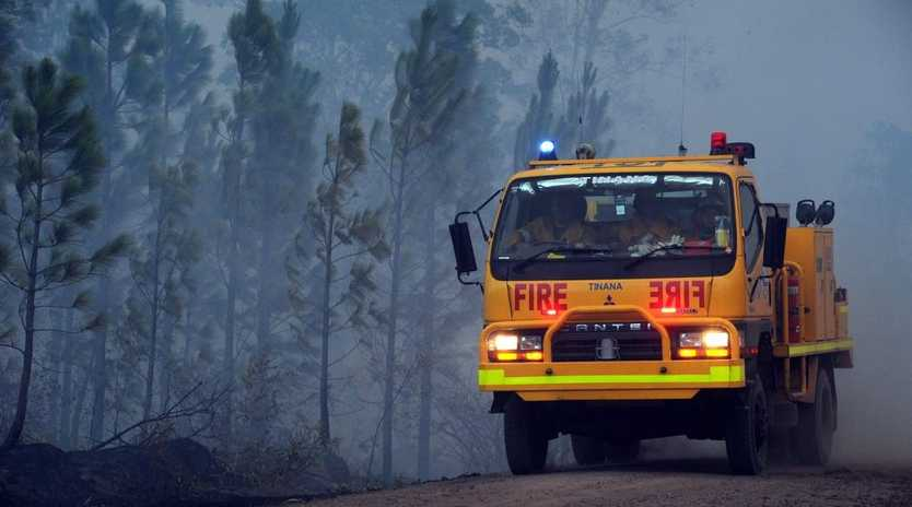Emergency services on their way to a fire burning in Tuan Forest near Maryborough.