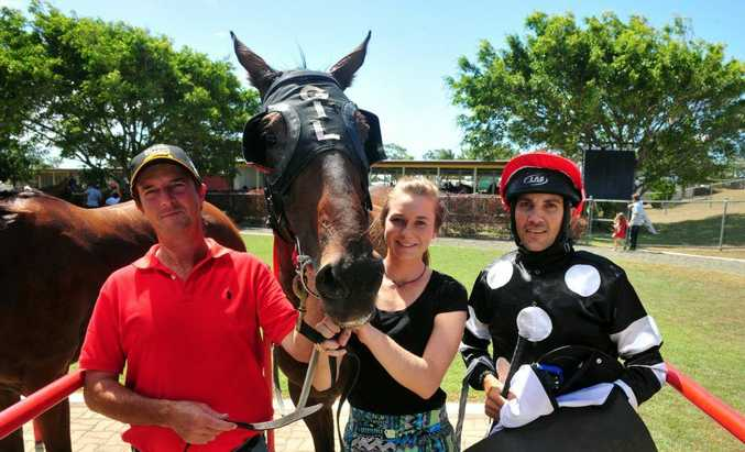 VICTORY TO TRAGEDY: Trainer Barry Gill, Shaye Du`Sell and jockey Kane St Vincent, with Cursu after winning the Greg Whalley Dental Handicap over 1380m at Thabeban Park, but just a short time later Sufferin Succotash broke a fetlock and had to euthanised. Photo: Max Fleet / NewsMail