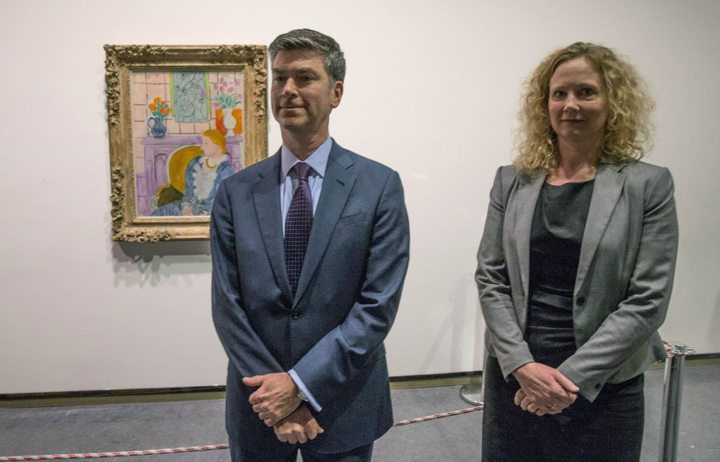 Tone Hansen (R), director of the Henie Onstad art gallery, and Christopher A Marinello, member of the Rosenberg family, pose in front of the painting titled