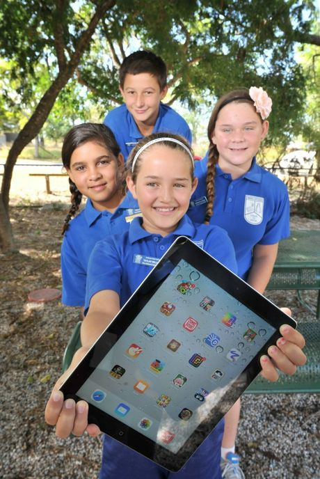 LEARNING AID: (From back) Taylah Williams, 10, Tallara Horan, 11, Samantha Creed, 11, and Zyrone Andrews, 11, would love to win The Observer's iPad competition.