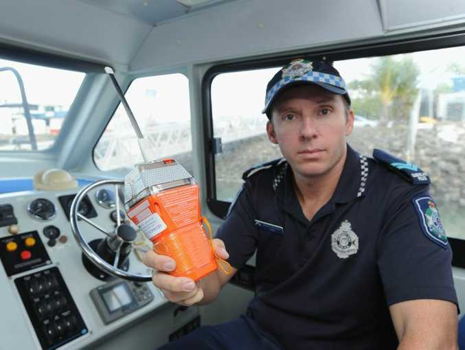 Hervey Bay Water Police Senior Constable Shannon Gray with an EPIRB.