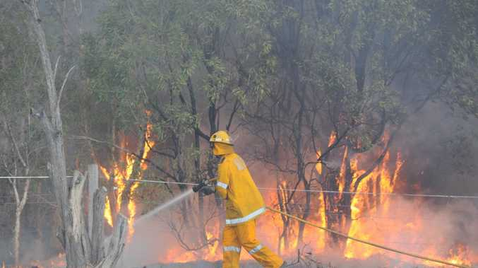 Rural firies at a fire burning on Dern's Dr at Takura on Sunday.