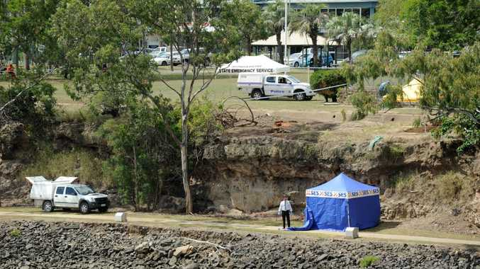 CORDONED OFF: Police investigated after a body was found next to the Burnett River just east of the traffic bridge.