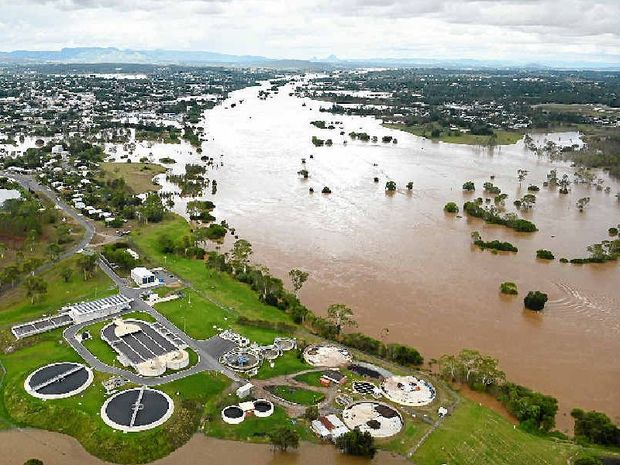 "IN CHARGE: An aerial photo of the 2013 Gympie flood – the Premier has told Gympie Regional Council to hurry up and ""deal with the issue""."