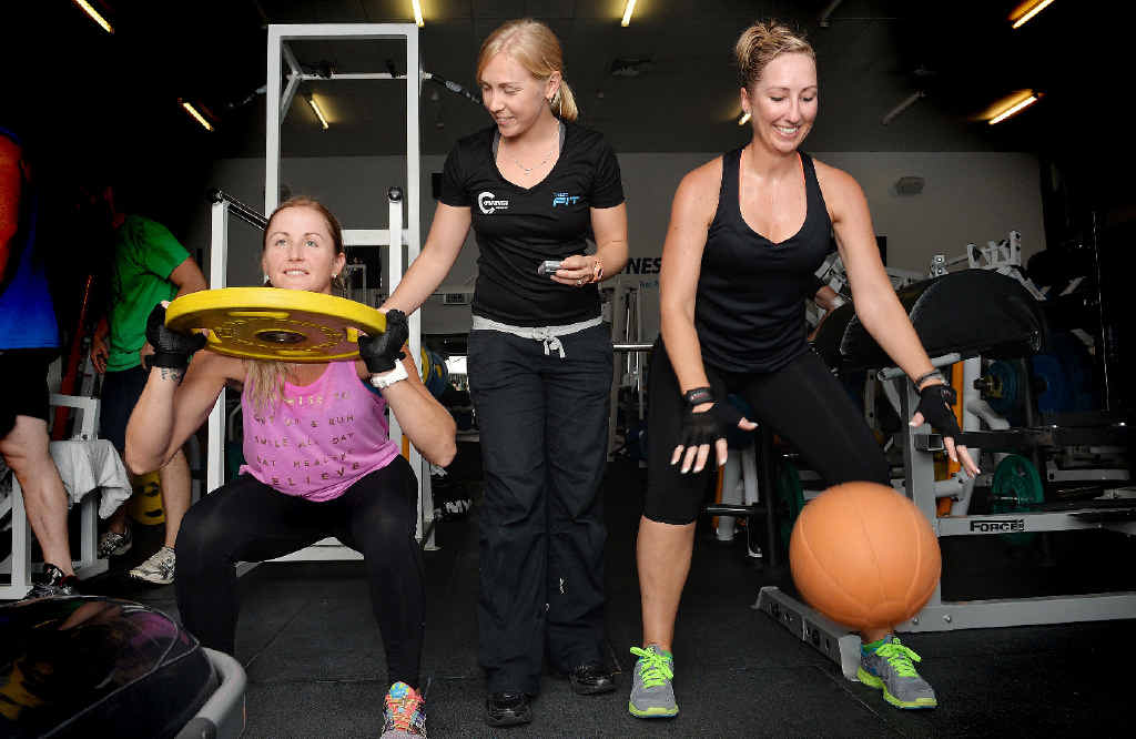 INTENSE EXERCISE: City Fitness head personal trainer Ashlee Hirst (centre) helps Amara Douglas (left) and Karlie Wallace do some high intensity interval training.