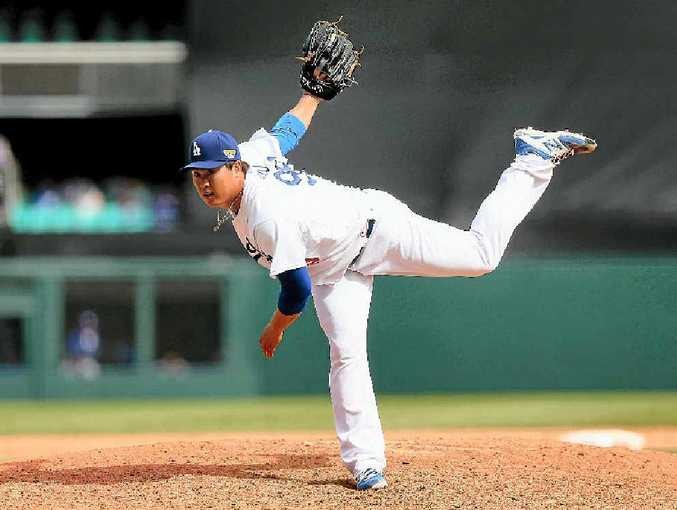 PITCHING: Hyan-Jin Ryu of the Dodgers pitches at the SCG in the win over the Arizona Diamondbacks yesterday.