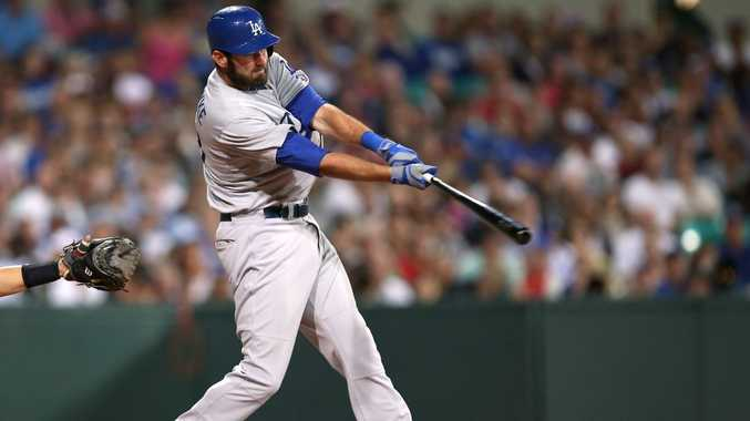 The Dodgers' Scott Van Slyke hits a two-run home run in the Major League Baseball opening game between the Los Angeles Dodgers and Arizona Diamondbacks at the Sydney Cricket ground in Sydney, Saturday, March 22, 2014.