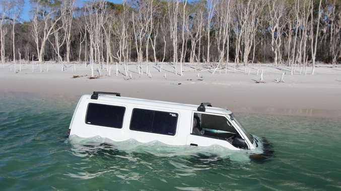 A four-wheel drive van underwater on Fraser Island.