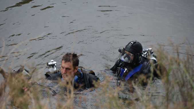 Police divers scour the Macintyre River at Goondiwindi during a search for clues in the suspected murder case of 24-year-old Alexis Jeffery.