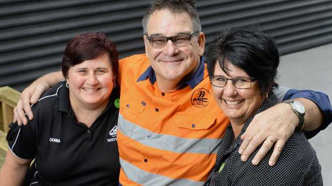 TRUE FRIENDS: Apprenticeships QLD safety officer Donna Templeton (left) and employment consultant Nadine Muller welcome field officer Phil Hortz from Mates in Construction.