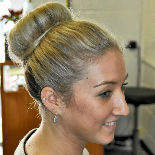Step 4. Finish off with a touch of hair spray. This style can be worn casually or dressed up with a braid.