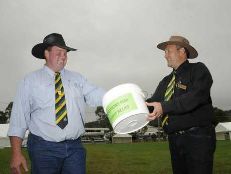 Cameron Collins and Wayne Bradshaw shake the donation bucket.