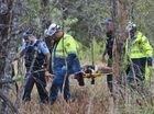 Police escort alleged robber from bushland on stretcher