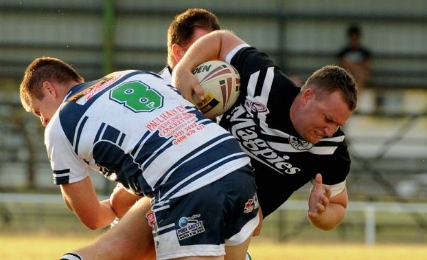 Brother's Nathan Mitchell tackles Miriam Vale player in the match at Eskdale Park on Saturday. Photo: Robyne Cuerel / Fraser Coast Chronicle