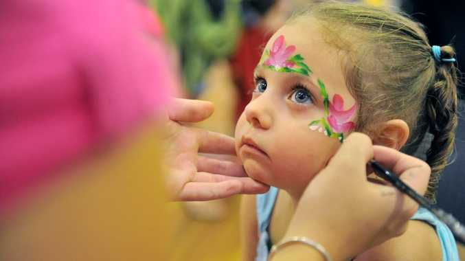Arliyah Gooda, 3, having her face painted during the National Playgroup Day held at the Gladstone PCYC.