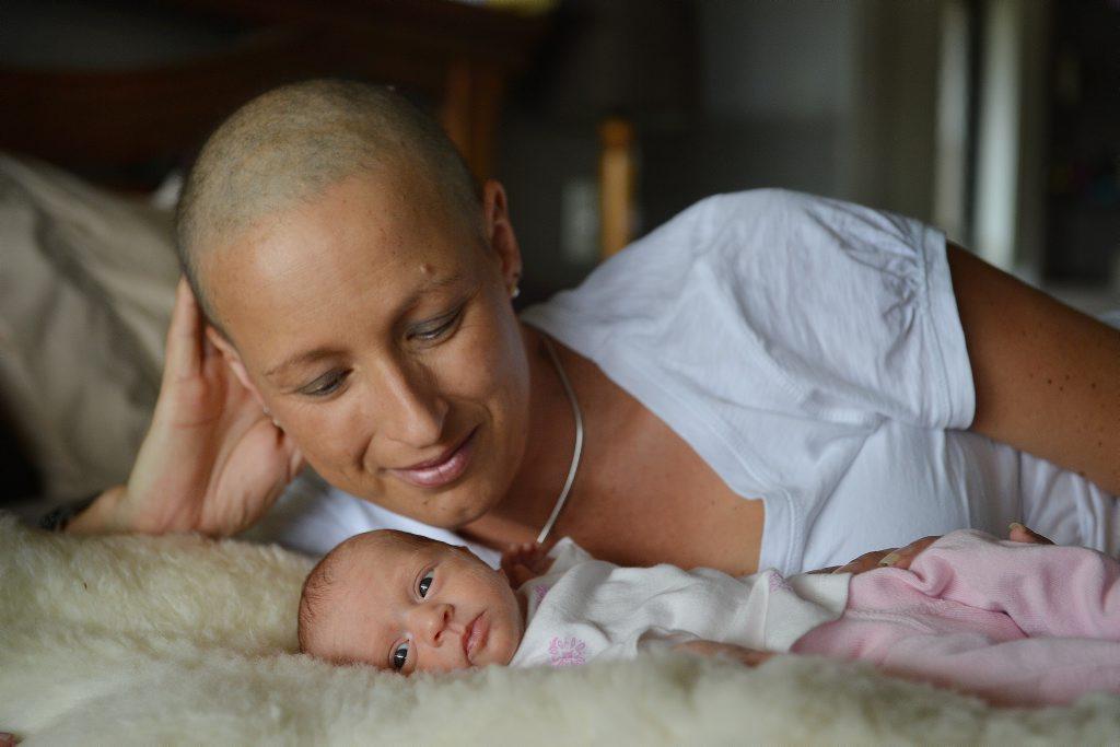 Leisa with new baby girl Billie Hehir in 2014.