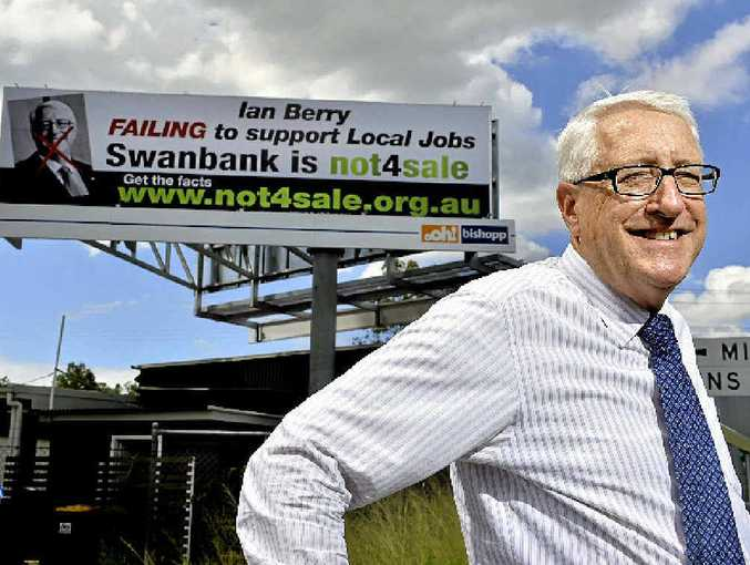 PHILOSOPHICAL: Ipswich Member Ian Berry in front of the billboard at the intersection of Mining Street and Brisbane Road.
