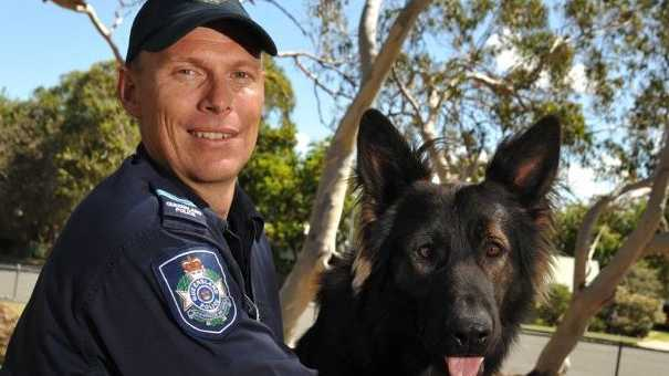 Police dog handler Senior Constable Justin Mergard with DJ, one of two new police dogs for the Sunshine Coast, pictured here at the Coolum Beach facility.