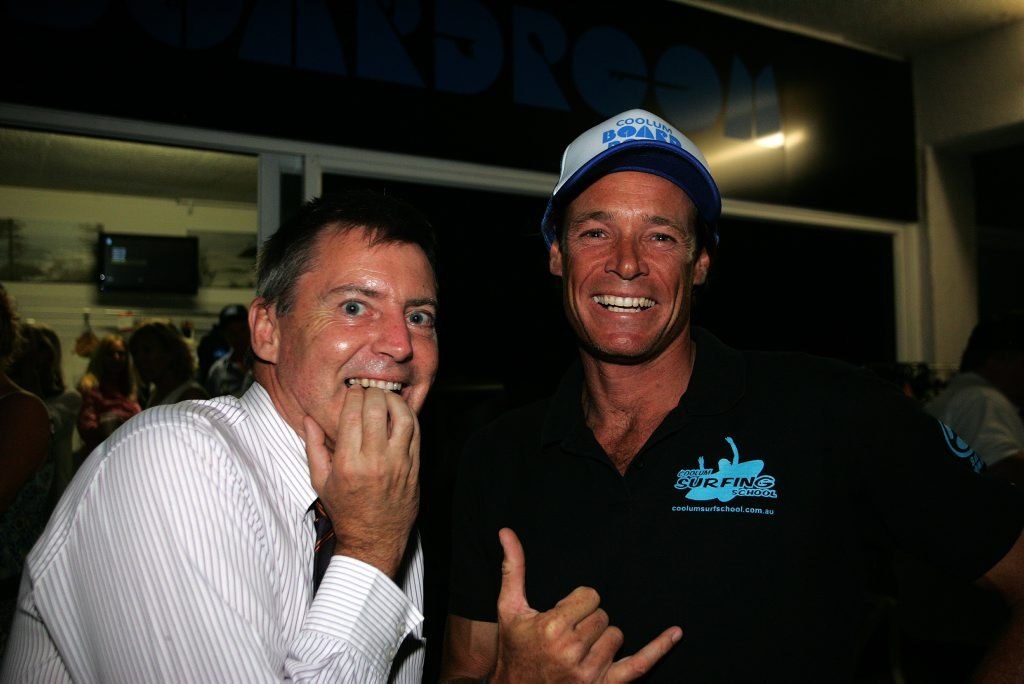 Image for sale: Councillor Steve Robinson hams it up at the Coolum Business and Tourism networking night after discovering he had won a surfing lesson with Coolum Boardroom owner Chris Kendall. Photo Mike Garry / Coolum & North Shore News