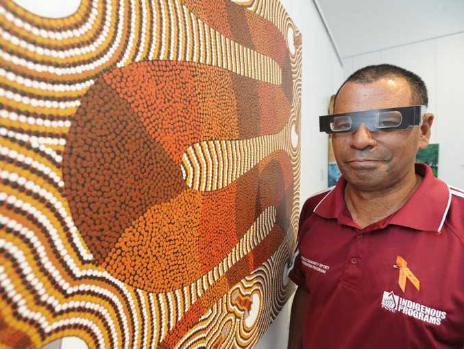 Les Raveneau with a work called Serpent on display at the Hervey Bay Regional Gallery.