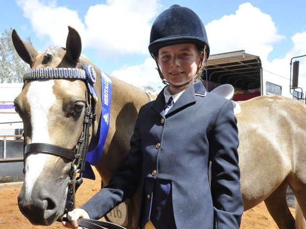 Ruby Goldsmith, 11, with her palomino pony Bordershow Moonlight. Ruby won the Child's Ridden Pony Under 12.2 hands on Friday.