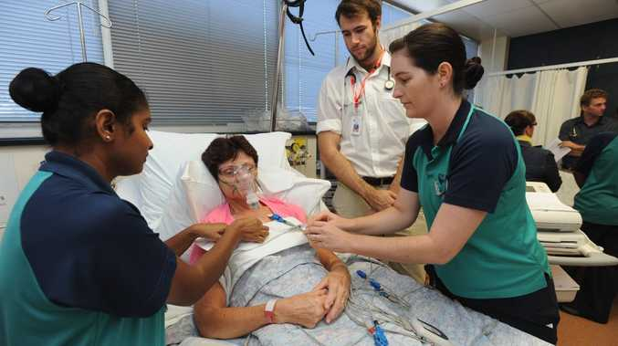 Third-year student Devika Gaundar, mock patient Fae Voysey, medical student Matthew Hearn and second-year student Angela Wessling at USQ's mock hospital exercise.