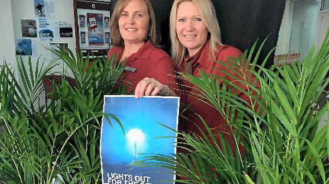 SWITCH OFF: Natasha Dimkovska and Michelle Johnson from Bendigo Bank are encouraging Gladstone homes and businesses to do their bit for Earth Hour tomorrow.
