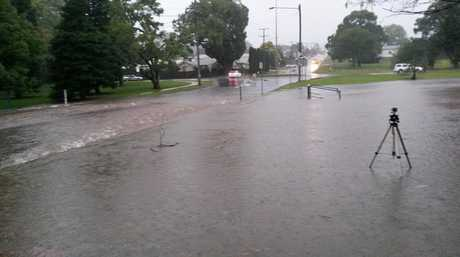 Flash flooding in South St, where photograph Grant Rolph witnessed several motorists driving through the fast flowing waters.