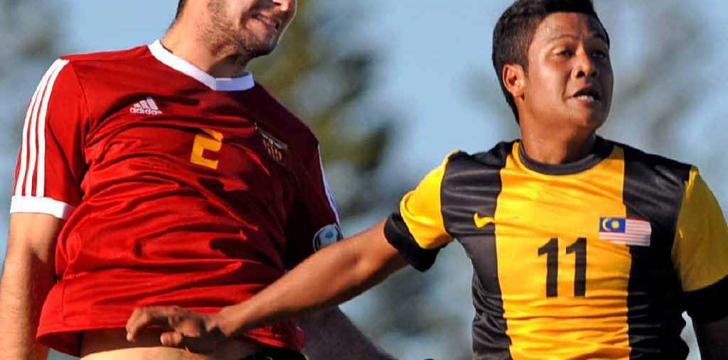 UP THERE ZAMMITT: The Fire's Wade Zammitt outjumps Muhammad Jafri Muhd Firdaus Chew in the match against Malaysia's Harimau Muda A at Bokarina. The Fire won 2-1.