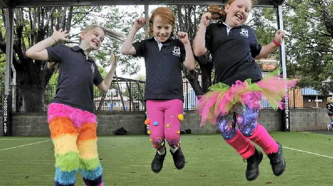 THE CRAZY ONES: Having a great time in their crazy pants at school are (from left) Amity Pomerenke, Saffron Andrew and Alyssa Collins.