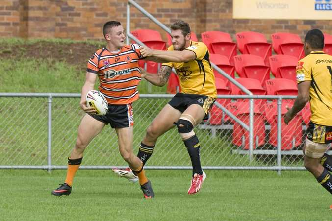 COME HERE: Gatton winger Scott Cubit (right) tries to tackle Souths five-eighth Sean Loxley at Clive Berghofer Stadium.