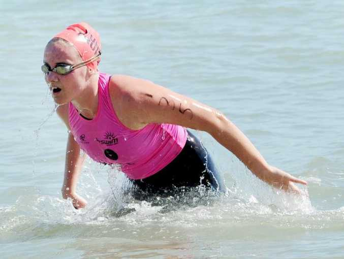 The annual Pier to Pub Ocean Swim - 'The Young Ones', Chloe Baldwin was the second female in. Photo: Valerie Horton / Fraser Coast Chronicle