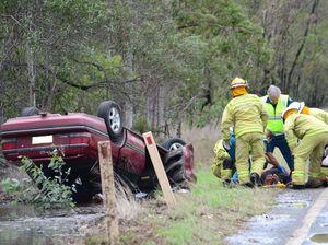 Motorist injured after car rolls on highway