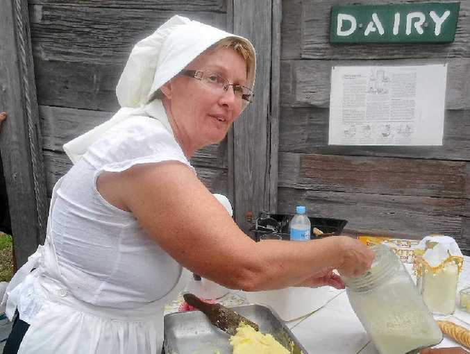 Jill Harvey, a member of the Woocoo Historical Society, puts on a demonstration at the Brooweena Museum.